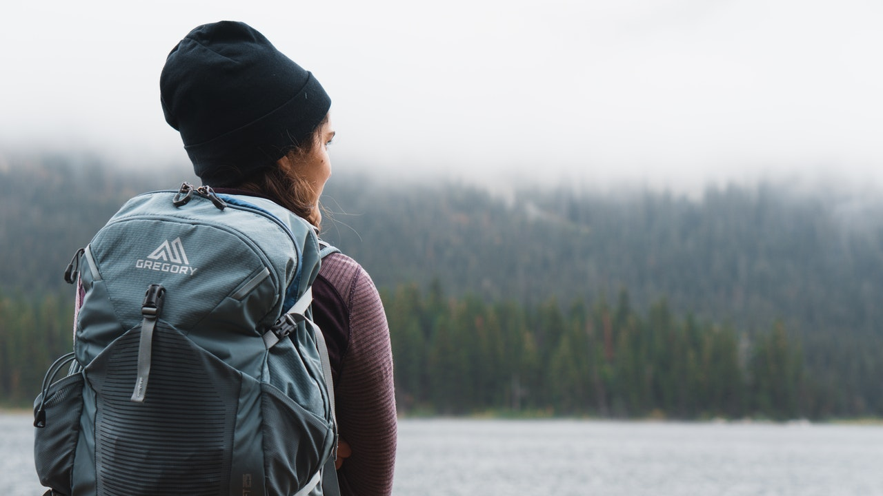 close up photography of woman carrying gray backpack 3334048