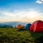 photo of pitched dome tents overlooking mountain ranges 1687845